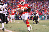 Chiefs running back Larry Johnson runs around the left end for a two-yard touchdown during the third quarter against the Jacksonville Jaguars at Arrowhead Stadium in Kansas City, Missouri on December 31, 2006. The Chiefs won 35-30.