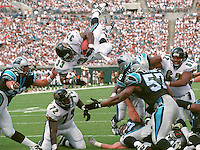Jacksonville Jaguars running back #33 James Stewart scores on of his five touchdown in the game soaring offensive tackle #72 Leon Searcy.