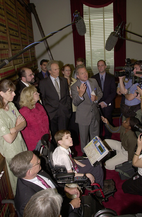 Eastwood C. 6(DG) 051800 -- Clint Eastwood and  Mark Adam Foley, R-FL., during a press conference on Americans with Disabilities Act.