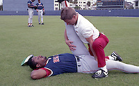 Boston Red Sox trainer Gordie Hurlbert stretches Herm Winningham during spring training circa 1992 at Chain of Lakes Park in Winter Haven, Florida.  (MJA/Four Seam Images)