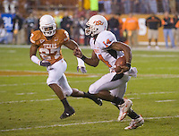 04 November 2006: Oklahoma State quarterback Bobby Reid (#14) tries to run past Texas defender Michael Griffin (#27) during the Texas Longhorns 36-10 victory over the Oklahoma State University Cowboys at Darrel K Royal Memorial Stadium in Austin, Texas.