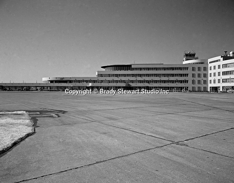 Pittsburgh PA 1953: View of the gates and terminal at the Greater Pittsburgh Airport in 1953. In 1944, Allegheny County officials proposed to expand the military airport with the addition of a commercial passenger terminal in order to relieve the Allegheny County Airport, which was built in 1926 and whose capacity was quickly becoming insufficient to support the growing demand for air travel.  The new airport, christened as Greater Pittsburgh Airport opened on May 31, 1952. The first flight occurred on June 3, 1952.