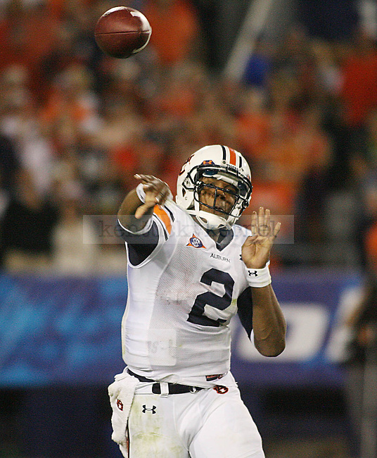 Auburn quarterbcak Cam Newton throws a pass against UK in the second half at Commonwealth Stadium on Saturday, Oct. 9, 2010. Photo by Scott Hannigan | Staff
