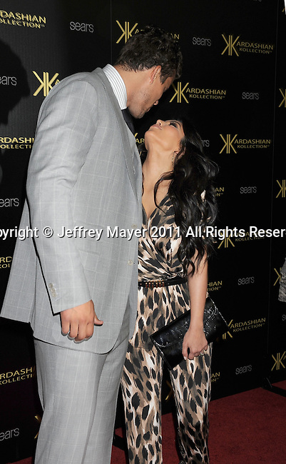 HOLLYWOOD, CA - AUGUST 17: Kris Humphries and Kim Kardashian attend the Kardashian Kollection Launch Party at The Colony on August 17, 2011 in Hollywood, California.
