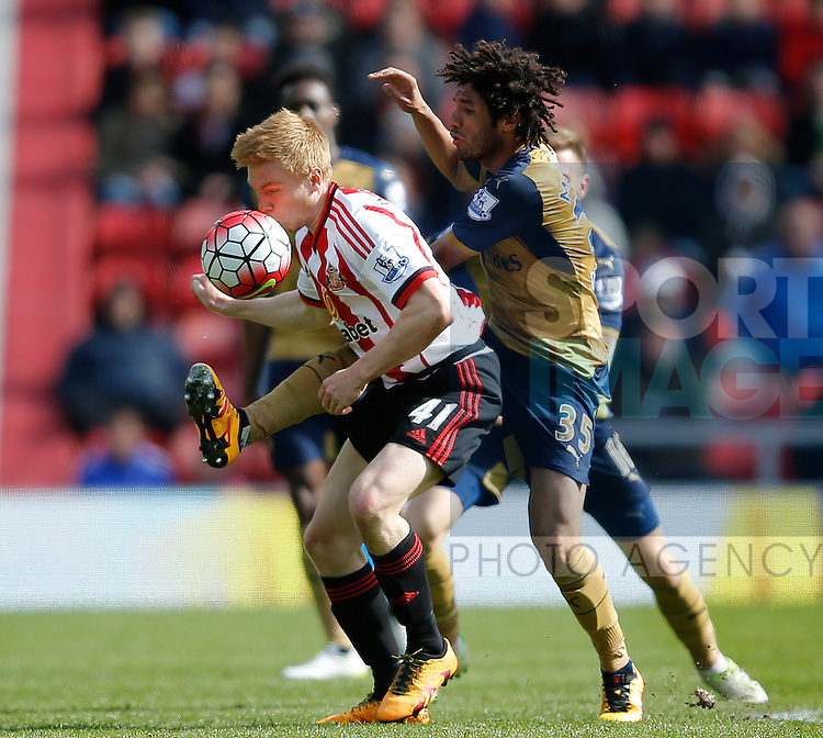 Mohamed Elneny of Arsenal tackles Duncan Watmore of Sunderland as he kisses the ball bringing it under control during the Barclays Premier League match at  Stadium of Light. Photo credit should read: Simon Bellis/Sportimage
