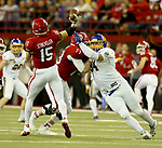 VERMILLION, SD - NOVEMBER 18: Kellen Soulek #94 from South Dakota State University is blocked by Cody Jennings #73 from the University of South Dakota as quarterback Chris Streveler #15 throws a pass during their game Saturday afternoon at the DakotaDome in Vermillion. (Photo by Dave Eggen/Inertia)