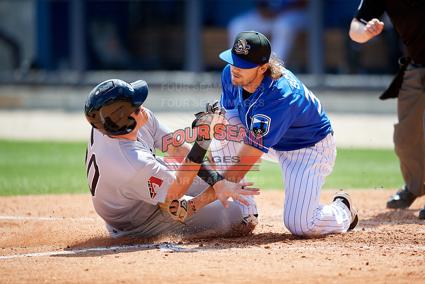 Biloxi Shuckers relief pitcher Tayler Scott (31) puts a tag on Kevin Cron (50) as he slides home during a game against the Jackson Generals on April 23, 2017 at MGM Park in Biloxi, Mississippi.  Biloxi defeated Jackson 3-2.  (Mike Janes/Four Seam Images)