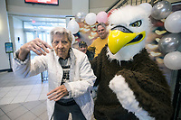 Dee Morrall, a resident of Primrose Retirement Community in Rogers, dances with Eddie the Eagle Thursday, Feb. 13, 2020, during the Student Ambassador and Government Association's Valentine's Cookie Day at Northwest Arkansas Community College in Bentonville. Residents of Primrose communities across the country took part in an annual day of random acts of kindness. Residents and staff passed out Amazon gift cards and candy to students, encouraging them to pay it forward. Students could also decorate sugar cookies, select a free 'blind date with a book' from the Sigma Kappa Delta English Honor Society and take pictures with school mascot Eddie the Eagle during the event. Check out nwaonline.com/200214Daily/ for today's photo gallery.<br /> (NWA Democrat-Gazette/Ben Goff)