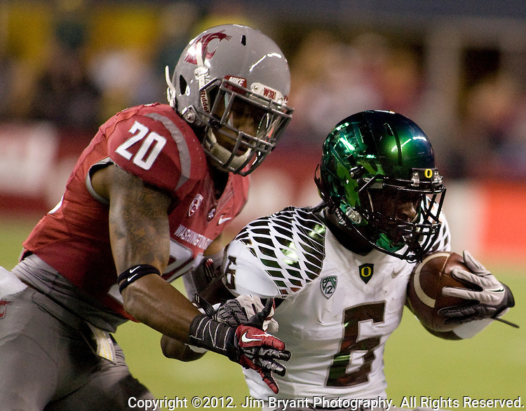 Washington State Cougars defensive back pushes  Oregon Duck's De'Anthony Thomas out of bounds at CenturyLink Field in Seattle, Washington on September 29, 2012.  2nd Ranked Oregon beat Washington State 51-26.   ©2012. Jim Bryant Photo. All Rights Reserved.