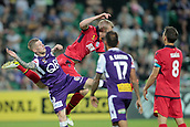 November 4th 2017, nib Stadium, Perth, Australia; A-League football, Perth Glory versus Adelaide United; Jordan Elsey from Adelaide United gets airborne over Andy Keogh of the Perth Glory