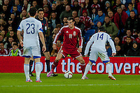 Wednesday 4th  December 2013 Pictured:  ( l-r )  Marios Nikolaou of Cyprus  Gareth Bale of Wales  and Vincent Laban  of Cyprus <br /> Re: UEFA European Championship Wales v Cyprus at the Cardiff City Stadium, Cardiff, Wales, UK