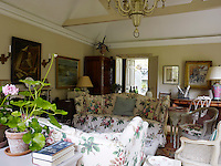 The large comfortable sofas in the garden room are upholstered in rose chintz called Georgina by Nicholas Herbert