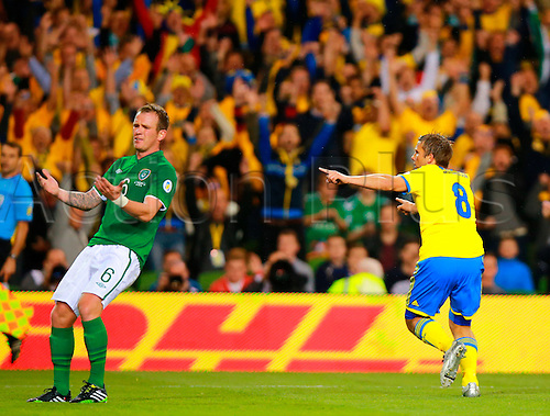 06.09.2013 Dublin, Ireland. Anders Svensson (Sweden)  runs to the fans to celebrate scoring during the 2014 World Cup Qualifier between Republic of Ireland and Sweden from the Aviva Stadium.