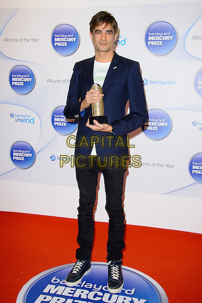Jon Hopkins<br /> Barclaycard Mercury Prize Nominations at the Hospital, Endell Street.<br /> Where: London, England.<br /> 11th September 2013<br /> full length blue suit jacket black jeans denim award trophy winner <br /> CAP/CJ<br /> &copy;Chris Joseph/Capital Pictures