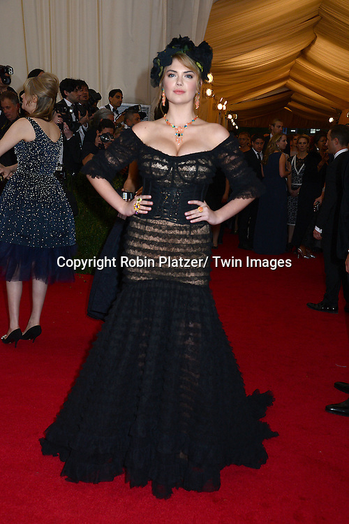 Kate Upton attends the Costume Institute Benefit on May 5, 2014 at the Metropolitan Museum of Art in New York City, NY, USA. The gala celebrated the opening of Charles James: Beyond Fashion and the new Anna Wintour Costume Center.