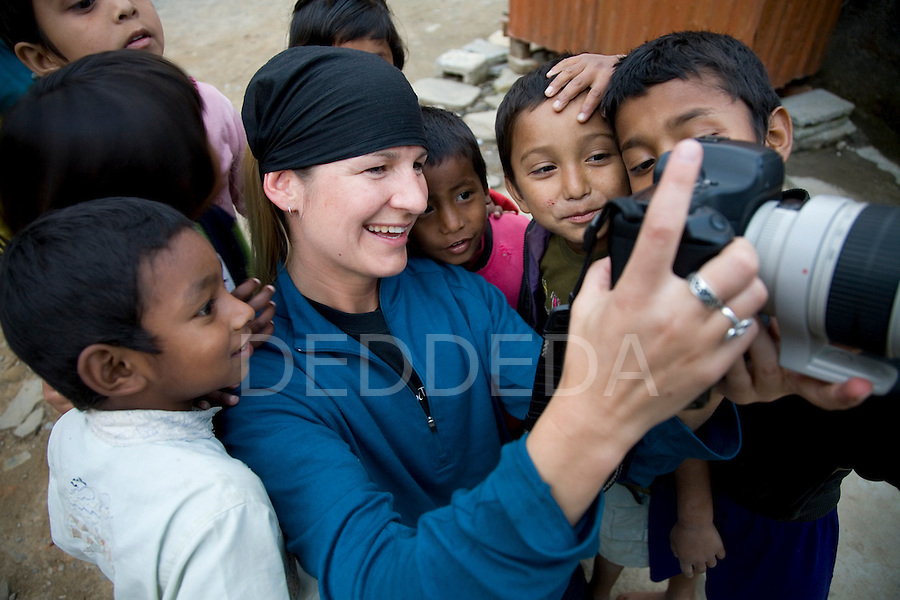 Deddeda shows some children photos that she took of them at an orphanage in Pokhara, Nepal.