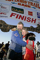 Saturday March 17, 2007  - Nome, Alaska ----   Tekla Monson, daugther of the late Susan Butcher, honorary musher of the 2007 race, hugs  her father, David Monson at the Nome finish line burl arch after the two completed a 700 mile journey in honor of Susan