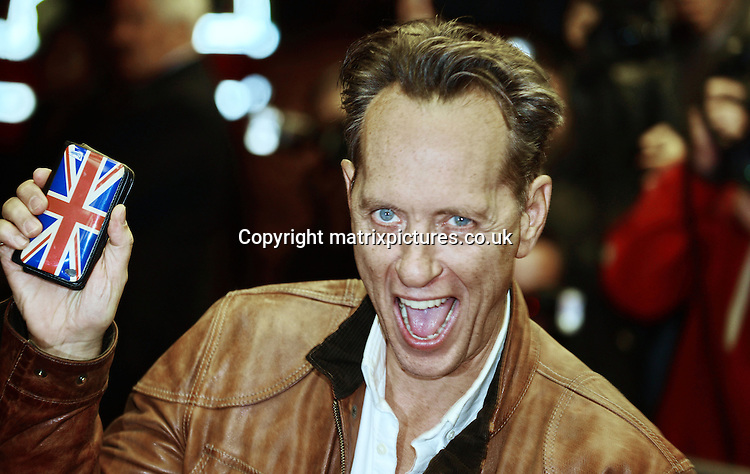 NON EXCLUSIVE PICTURE: MATRIXPICTURES.CO.UK<br /> PLEASE CREDIT ALL USES<br /> <br /> WORLD RIGHTS<br /> <br /> British-Swazi actor Richard E Grant attending the UK premiere of Dom Hemingway, at The Curzon Mayfair in London. <br /> <br /> OCTOBER 28th 2013<br /> <br /> REF: SLI 137031
