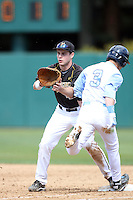 Dane Opel, #47, of the Missouri Tigers waits for the throw at first base against the North Carolina Tar Heels at Dedeaux Field on February 20, 2011 in Los Angeles,California. Photo by Larry Goren/Four Seam Images