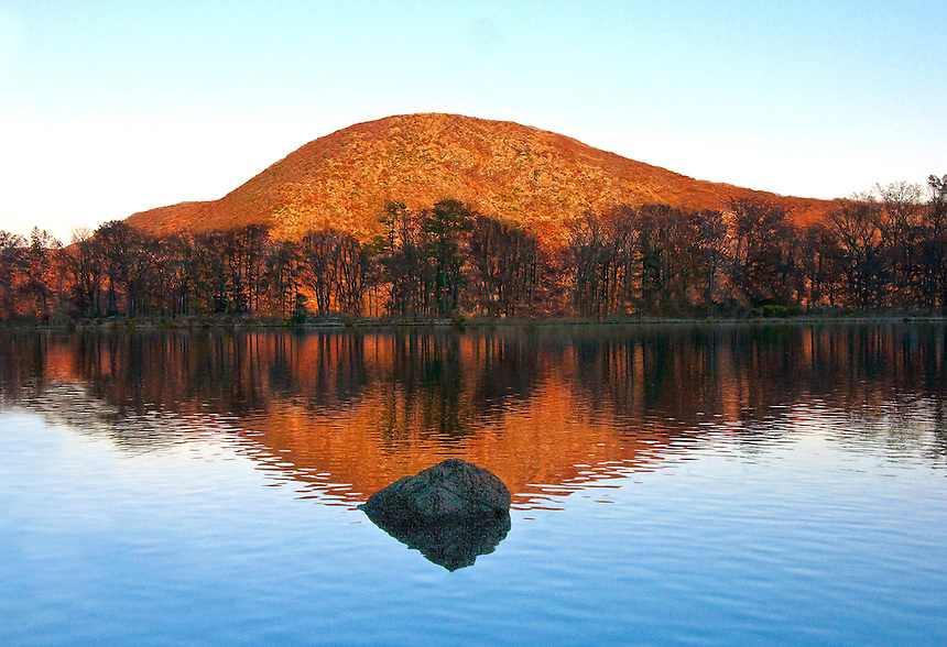 """A Reflection of """"Anthony's Nose"""" on Hessian Lake, Bear Mountain NY. A reflection on a mountain lake."""