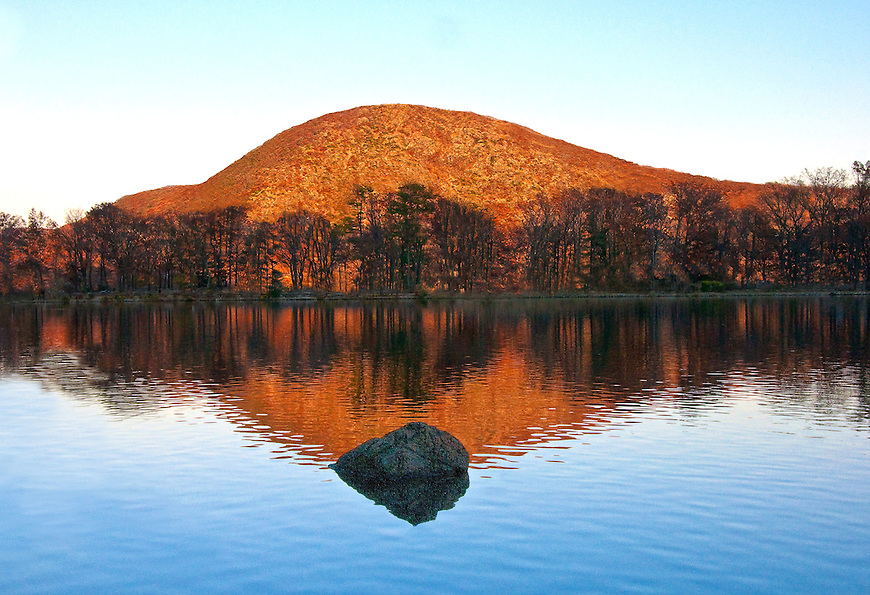 "A Reflection of ""Anthony's Nose"" on Hessian Lake, Bear Mountain NY. A reflection on a mountain lake."
