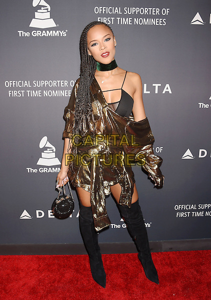HOLLYWOOD, CA - FEBRUARY 09: Singer-songwriter Serayah McNeill attends Delta Air Lines official Grammy event featuring private performance and interactive evening with Halsey at Beauty &amp; Essex, adjacent to the new Dream Hollywood to celebrate the 59th Annual GRAMMY Awards on February 9, 2017 in Los Angeles, California.<br /> CAP/ROT/TM<br /> &copy;TM/ROT/Capital Pictures