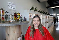 Eden Garrett, with Eden's Botanicals, stands at the entrance of her new brick and mortar store Friday, February 7, 2020, located at Uptown Apartments and Retail in Fayetteville. Garrett started her business with a mobile flower truck. Check out nwadg.com/photos for a photo gallery.<br /> (NWA Democrat-Gazette/David Gottschalk)