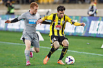 Wellington Phoenix's Thomas Doyle, right, holds Newcastle United's Adam Campbell, left, at bay in the fourth match of the Football United Tour at Westpac Stadium, Wellington, New Zealand, Saturday, July 26, 2014. Credit: Dean Pemberton
