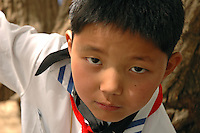 A young primary school student demonstrates his intensity durning kung fu practice in Lhasa, Tibet.