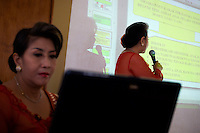 'Twin Teachers' Rian and Rossy present a lecture about education methods to local educators in Lampung province. Since the early 1990s, twin sisters Sri Rosyati (known as Rossy) and Sri Irianingsih (known as Rian) have used their family inheritance to set up and run 64 schools in different parts of Indonesia, providing primary education combined with practical skills to some of the country's most deprived children.