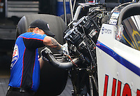 Apr 25, 2015; Baytown, TX, USA; A crew member works on the engine for NHRA top fuel driver Richie Crampton during qualifying for the Spring Nationals at Royal Purple Raceway. Mandatory Credit: Mark J. Rebilas-