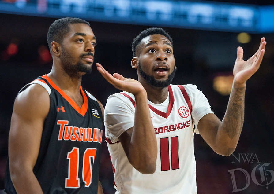 NWA Democrat-Gazette/BEN GOFF @NWABENGOFF <br /> Keyshawn Embery-Simpson (11) of Arkansas and Myles Jones of Tusculum react to a call in the first half Friday, Oct. 26, 2018, during an exhibition game in Bud Walton Arena in Fayetteville.