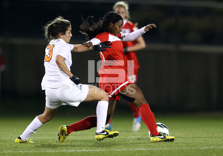BOYDS, MARYLAND - April 06, 2013:  Jasmyne Spencer (20) of The Washington Spirit shields the ball from Molly Menchel (13) of the University of Virginia women's soccer team in a NWSL (National Women's Soccer League) pre season exhibition game at Maryland Soccerplex in Boyds, Maryland on April 06. Virginia won 6-3.