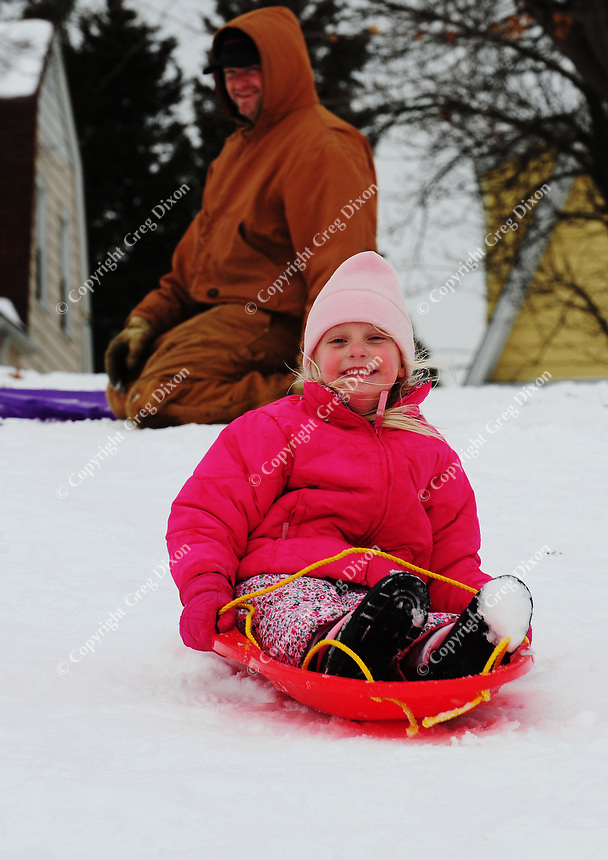 Doug and Esa Dederich go sledding in Olbrich Park on Saturday in Madison