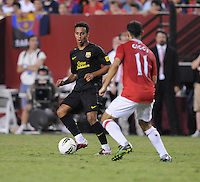 FC Barcelona midfielder Thiago Alcantara (4) goes against Manchester United midfielder Ryan Giggs (11) Manchester United defeated Barcelona FC 2-1 at FedEx Field in Landover, MD Saturday July 30, 2011.