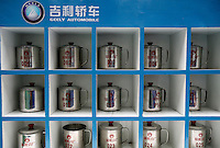 Worker's tea cups on a shelf at the Geely Automobiles Factory in Taizhou, Zhejiang Province, China. Along with other auto makers in China, Geely is now looking overseas to sell its vehicles as stock increases and domestic margine declines. China is currently the world's 4th largest auto maker, plans to boost vehicle and automobile components exports by 15 folds to more than 120 billion yuan (15 billion US) in the next 10 years..