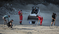 Pictured: Special forensics police officers and Hellenic Red Cross volunteers use rakes to search through soil in a field in Kos, Greece. Tuesday 04 October 2016<br /> Re: Police teams led by South Yorkshire Police, searching for missing toddler Ben Needham on the Greek island of Kos have moved to a new area in the field they are searching.<br /> Ben, from Sheffield, was 21 months old when he disappeared on 24 July 1991 during a family holiday.<br /> Digging has begun at a new site after a fresh line of inquiry suggested he could have been crushed by a digger.