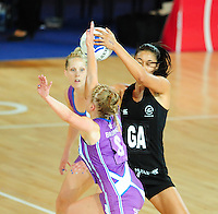 New Zealand's Maria Tutaia claims the ball under pressure from Scotland's Claire Brownie<br /> <br /> Scotland Vs New Zealand - preliminary round - group A<br /> <br /> Photographer Chris Vaughan/CameraSport<br /> <br /> 20th Commonwealth Games - Day 3 - Saturday 26th July 2014 - Netball - SECC - Glasgow - UK<br /> <br /> © CameraSport - 43 Linden Ave. Countesthorpe. Leicester. England. LE8 5PG - Tel: +44 (0) 116 277 4147 - admin@camerasport.com - www.camerasport.com