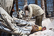 Migrant labourers from Rajasthan and other states are seen cutting Dholpur stone on Dr. Bhimrao Ambedkar Smarak Parivartan Sthal built by Uttar Pradesh chief minister, Mayawati in Lucknow, India. Mayawati is channeling huge state funds into making structures and sand stone monstrosities using public funds in the state capital, Lucknow.