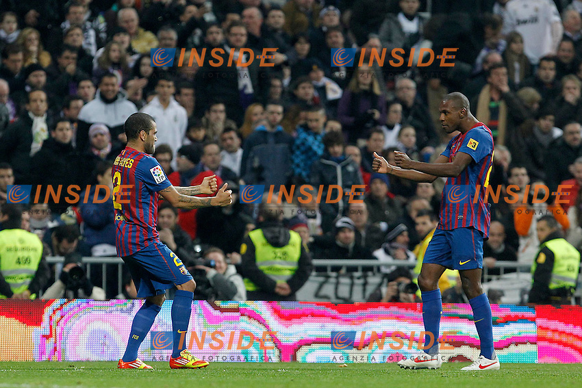 FC Barcelona's Eric Abidal (r) and Daniel Alves (l) celebrate goal during Spanish King's Cup match.January 18,2011. (Insidefoto / Acero / Alterphotos) .Real Madrid Vs Barcellona.ITALY ONLY