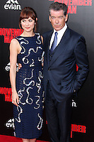 HOLLYWOOD, LOS ANGELES, CA, USA - AUGUST 13: Olga Kurylenko, Pierce Brosnan at the World Premiere Of Relativity Media's 'The November Man' held at the TCL Chinese Theatre on August 13, 2014 in Hollywood, Los Angeles, California, United States. (Photo by Xavier Collin/Celebrity Monitor)