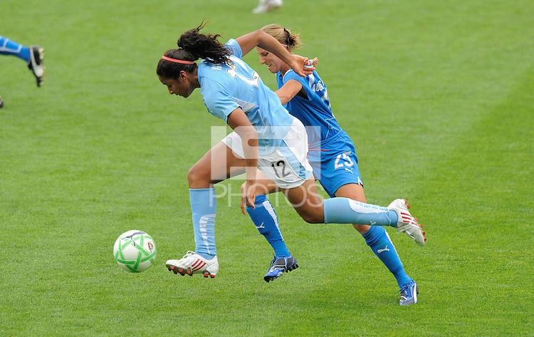 #12 Chioma Igwe of the Chicago Reds Stars pushes the ball up field against  #25  Nancy Augustyniak Goffi of the Boston Breakers. Boston Breaker beat the Chicago Red Stars 2-0 on June 21, 2009 in Chicago, IL.