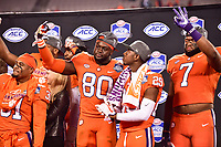 Charlotte, NC - DEC 2, 2017: Clemson Tigers tight end Milan Richard (80) and Clemson Tigers cornerback Marcus Edmond (29) celebrate on stage after winning the ACC Championship game over Miami 38-3 at Bank of America Stadium Charlotte, North Carolina. (Photo by Phil Peters/Media Images International)