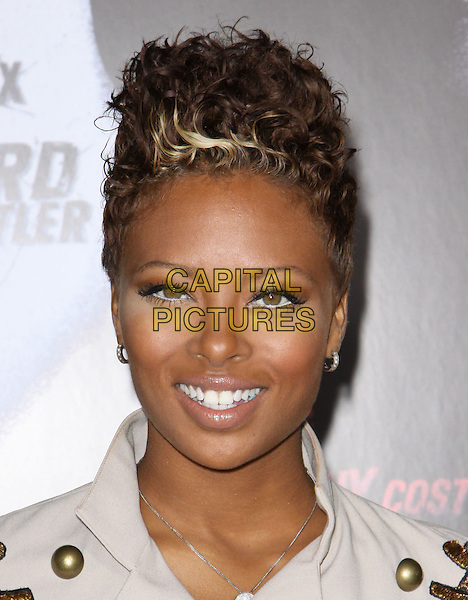 "EVA MARCILLE.Premiere Screening Of Overture Films' ""Law Abiding Citizen"" held At The Grauman Chinese Theatre, Hollywood, California, USA..October 6th, 2009.headshot portrait beige gold buttons eyeliner white .CAP/ADM/KB.©Kevan Brooks/AdMedia/Capital Pictures."