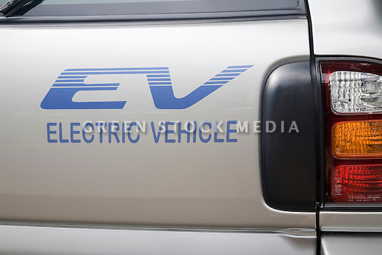 A close up of 'EV Electric Vehicle' sticker on Toyota RAV4. Electric Vehicle Rally in Palo Alto, hosted by the Silicon Valley Chapter of the Electric Auto Association, Palo Alto, California, USA