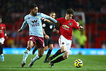 Douglas Luiz of Aston Villa and Daniel James of Manchester United during the Premier League match at Old Trafford, Manchester. Picture date: 1st December 2019. Picture credit should read: Phil Oldham/Sportimage