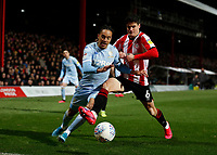 11th February 2020; Griffin Park, London, England; English Championship Football, Brentford FC versus Leeds United; Christian Norgaard of Brentford challenges Helder Costa of Leeds United