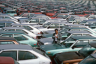 June, 1981. Newark, New Jersey. The New Jersey harbor is flooded with the first wave of sub-compact cars imported from Japan.
