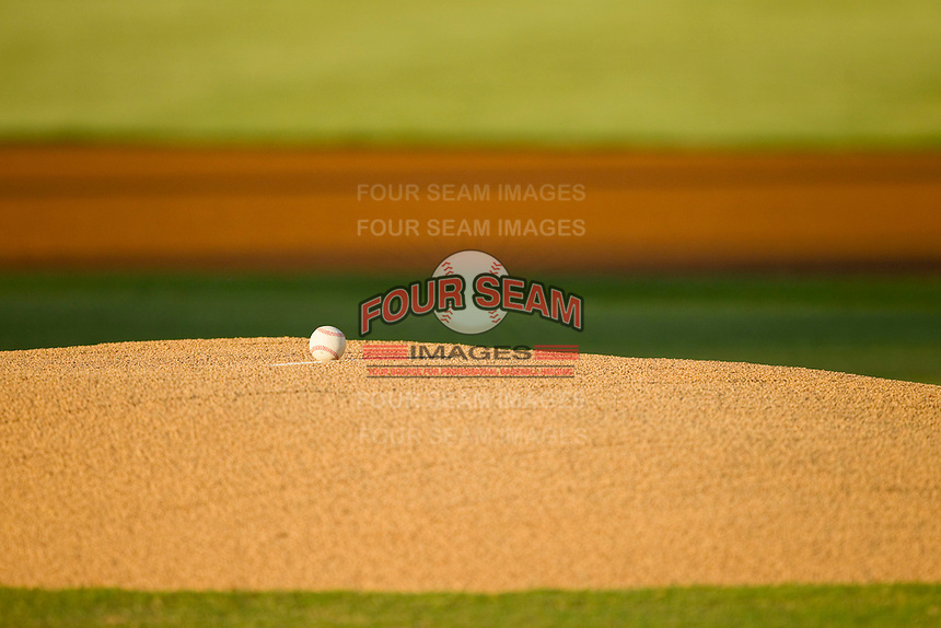 A baseball sits on the pitchers mound waiting for the start of the South Atlantic League game between the Rome Braves and the Kannapolis Intimidators at CMC-Northeast Stadium on August 24, 2013 in Kannapolis, North Carolina.  The Intimidators defeated the Braves 6-1.  (Brian Westerholt/Four Seam Images)