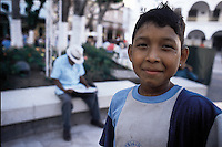 A boy looks straight at the camera in the central plaza of the port city of Veracruz, Mexico 2002